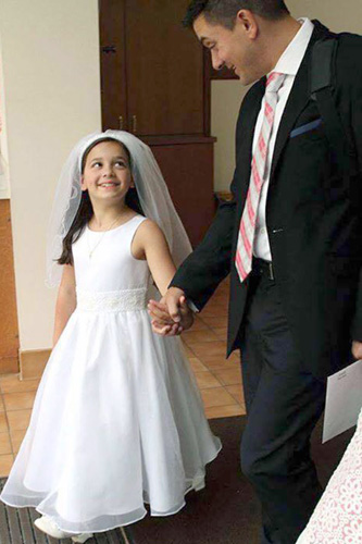 First communion photo of dad and daughter.